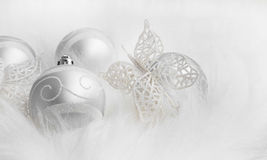 Christmas silver decorations in white fur Royalty Free Stock Image