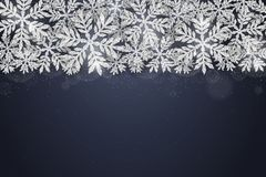 Christmas silver glittering snowflakes background Stock Photos