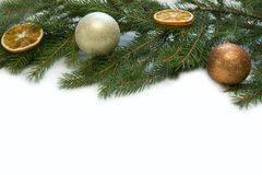 Christmas silver and gold ball with twig of fir Royalty Free Stock Image