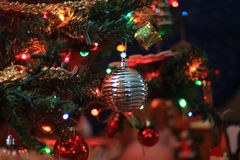 Christmas Silver Ornament. Close up of silver ornament on a tree Royalty Free Stock Photo