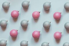 Christmas silver and pink baubles decoration pattern on pastel blue. Minimal flat lay composition. Christmas silver and pink baubles decoration pattern on stock photos