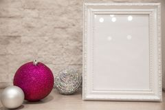 Christmas silver and purple violet balls and silver beads on brick wall background. Copy space. royalty free stock images