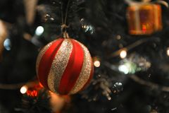 Christmas Silver red ball hanging on a beautiful Chrismas tree s. Urrounded by red and white shinning ball Royalty Free Stock Image
