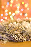 Christmas silver wreath. On golden background with colored lights royalty free stock photos