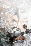 Christmas, xmas silver cup of whipped cream on shiny plate, white reindeer, and metallic background, with sweets, cinnamon, winter royalty free stock photos