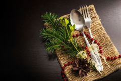 Christmas silverware at dark wooden table Stock Images