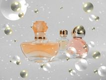 Christmas simbols perfume bottles. In the bubbles and snow isolated on white background Stock Photo