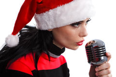 Christmas Singer with microphone Royalty Free Stock Image