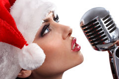 Christmas Singer with microphone Stock Photos