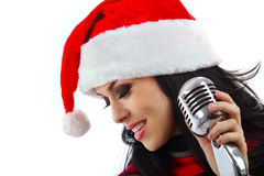 Christmas Singer with microphone Royalty Free Stock Photography