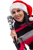 Christmas Singer with microphone Royalty Free Stock Photos