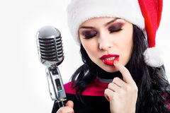 Christmas Singer with microphone Royalty Free Stock Images