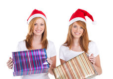 Christmas sisters with gifts Stock Image