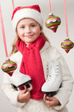 Christmas skating girl Stock Images