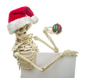 Christmas Skeleton Holding A Sign Stock Images