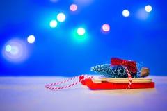 Christmas slay with christmas tree. On top Royalty Free Stock Photo
