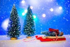 Christmas slay with christmas tree. On top Stock Image