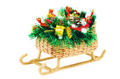 Christmas Sled. Christmas gift. Sled handmade, decorated with tinsel, toys, pine cones and candy. Isolated on a white background Stock Image