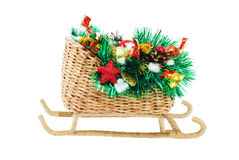 Christmas Sled. Christmas gift. Sled handmade, decorated with tinsel, toys, pine cones and candy. Isolated on a white background Royalty Free Stock Photo