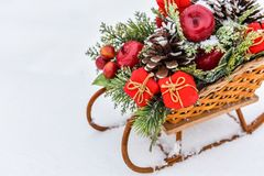 Christmas sled with gifts isolated on white snow. Background Stock Images