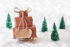 Christmas Sled On Snow With White Background, Copy Space Label. Sleigh Or Sled With Christmas Gifts Or Presents. Snowy Scenery With Snow And Trees. White Stock Photos