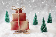 Christmas Sled On Snow With White Background, Snowflakes And Stars Stock Photo