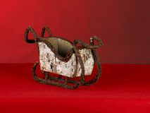 Christmas sleigh. Wicker christmas sleigh on a red background Stock Photo