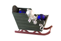 Christmas sleigh blue and white baubles Royalty Free Stock Images