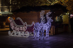 Christmas sleigh. Brightly lit sleigh with two deers. Christmas decoration Stock Photos