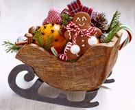 Christmas sleigh with gingerbread man Stock Image