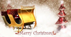 Christmas Sleigh. A golden old sleigh with red seats and Santa Claus's hat on a snowy background Royalty Free Stock Image