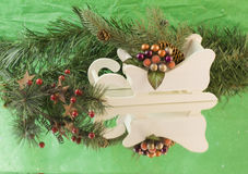 Christmas sleigh greenry Stock Photos