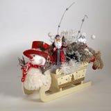 Christmas sleigh, Santa Claus, snowman. Ur-tree branch Royalty Free Stock Photo