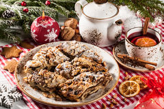 Christmas sliced cake on holiday table Stock Images
