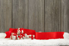 Christmas small gifts and red ribbon Royalty Free Stock Photography