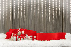Christmas small gifts and red ribbon Royalty Free Stock Photos