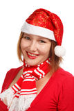 Christmas smile. Young woman in new year or christmas suit smiling isolated on white background Royalty Free Stock Photography