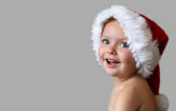 Christmas Smiles. Toddler with a Christmas hat and a big friendly smile Stock Photography