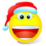 Christmas smiley. With red hat on Royalty Free Stock Photography