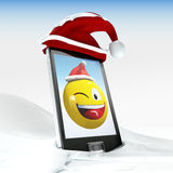 christmas smiley on generic mobile phone 3d illustrated Stock Images