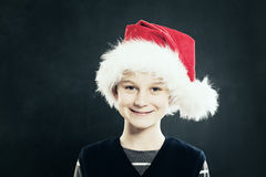 Christmas. Smiling Child in Santa Hat Stock Images