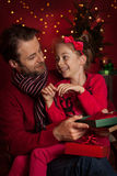 Christmas - smiling father and daughter enjoying gifts Royalty Free Stock Photos
