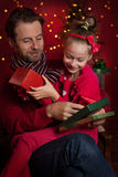 Christmas - smiling father and daughter enjoying present Stock Photo