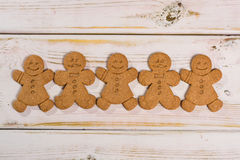Christmas Smiling Gingerbread Men On Rustic Wooden Background Stock Image