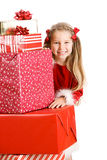 Christmas: Smiling Girl Behind Stack Of Christmas Gifts On White Stock Photography