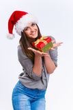 Christmas. Smiling happy girl in christmas hat with gift in her hair, isolated on a white background Royalty Free Stock Images