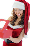 Christmas Smiling Woman. In red santa cap. isolated on a white background Stock Photography