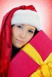 Christmas Smiling Woman. In red santa cap Stock Image