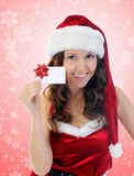 Christmas Smiling Woman. In red santa cap Stock Photos