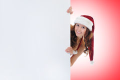 Christmas Smiling Woman. In red santa cap Royalty Free Stock Image